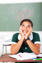 School girl daydreaming smiling teenage in classroom Royalty Free Stock Photos