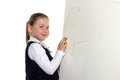 School girl erases from a board Stock Images