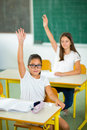 School girl raised hands in class Royalty Free Stock Photo