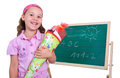 School girl with school cone in pink dress and hair band is associated a in front of the blackboard Royalty Free Stock Images