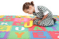 School girl in uniform and alphabet letter puzzle Royalty Free Stock Photo