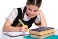 School girl in uniform writes Royalty Free Stock Photo