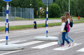 School girls on the zebra crossroad crossing street way to Stock Image