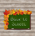 School green board with leaves on wooden texture illustration Royalty Free Stock Photo