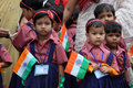 School independence day celebration by kids little in uniform celebrate indian holding national flag or tricolor event of kendriya Royalty Free Stock Photo