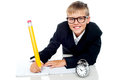 School kid finishing his assignment in time Royalty Free Stock Photo