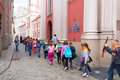 School kids excursion having an at the old square of the city in poznan poland Royalty Free Stock Photo