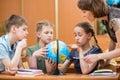 School kids studying a globe Royalty Free Stock Photo