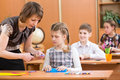 School kids work at lesson labour teacher helping pupil Royalty Free Stock Photography