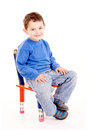 School little boy sitting in chair isolated in white Stock Images