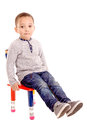 School little boy sitting in chair isolated in white Stock Photography
