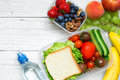 School lunch boxes with sandwich, fruits, vegetables and bottle of water and copy space Royalty Free Stock Photo