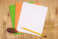 School notebooks, pencil and pine cone Royalty Free Stock Photo