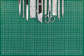 School and office stationery on green cutting mat. top view. Royalty Free Stock Photo