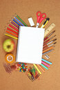 School and office supplies on cork board Royalty Free Stock Images
