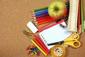 School and office supplies on cork board Royalty Free Stock Photo