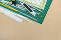 School or office supplies and tools on green cutting mat backgro Royalty Free Stock Photo
