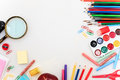 School set with notebooks, pencils, brush, scissors and apple on white background Royalty Free Stock Photo
