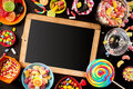 School slate surrounded by colorful candy Royalty Free Stock Photo