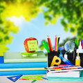School supplies on the background of autumn leaves Stock Image