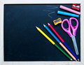School supplies on a black board Stock Images
