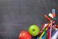 School supplies on blackboard background Royalty Free Stock Photo