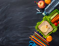 School supplies on blackboard background ready for your design Royalty Free Stock Photo