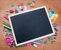 School supplies and blackboard with copy space on the table Stock Photography
