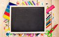 School supplies and blackboard with copy space on the table Stock Image