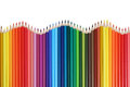 School supplies colored pencils forming a wave Royalty Free Stock Photo