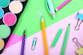 School supplies on colorful papers background Royalty Free Stock Photo