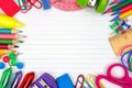 School supplies frame on lined paper background Royalty Free Stock Photo
