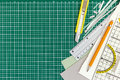 School supplies on green cutting mat background, view from above Royalty Free Stock Photo