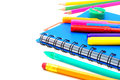 School supplies notebook close up with colorful pens and pencils over white Royalty Free Stock Image