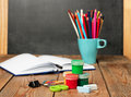 School supplies, open notebook and chalkboard Royalty Free Stock Photo