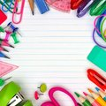 School supplies square frame on lined paper background Royalty Free Stock Photo