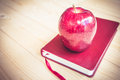 School teacher's desk with books and apple Royalty Free Stock Photo