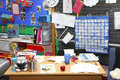 School teachers classroom desk uk busy Stock Image
