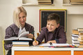 School tutor with young student. Helping. Royalty Free Stock Photo