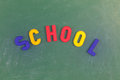 School written on a blackboard writen with colored letters Stock Images