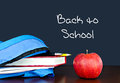 Schoolbag with books and fruit Stock Photos