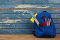 Schoolbag on wooden background Royalty Free Stock Photo