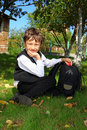 Schoolboy with backpack and apple Royalty Free Stock Photo