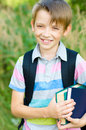 Schoolboy with backpack and books cute little outdoors Royalty Free Stock Photography