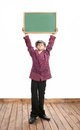 Schoolboy with blackboard funny is holding a Royalty Free Stock Image