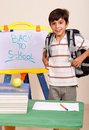 Schoolboy with books and backpack Royalty Free Stock Photo