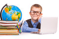 Schoolboy with books and laptop on a white Stock Image