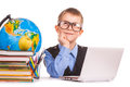 Schoolboy with books and laptop on a white Royalty Free Stock Photo
