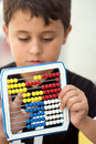 Schoolboy calculate with abacus Royalty Free Stock Photos