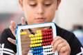 Schoolboy calculate with abacus Royalty Free Stock Images